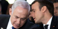 French President Emmanuel Macron (R) and Israeli Prime Minister Benjamin Netanyahu speak together during a ceremony commemorating the 75th anniversary of the Vel d'Hiv roundup, in Paris, France, July 16, 2017.     REUTERS/Kamil Zihnioglu/Pool