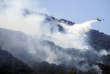 Un bombardier d'eau intervient sur un incendie près de Naples, le 17 juillet.