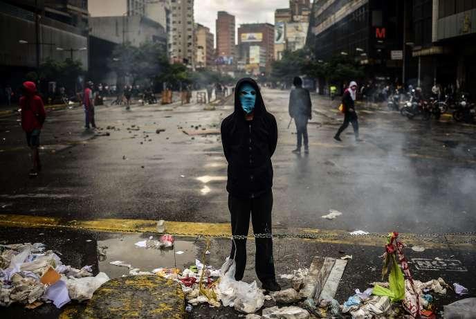 Un opposant à Caracas, mercredi 19 juillet.