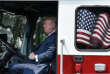 """President Donald Trump examines a fire truck from Wisconsin-based manufacturer Pierce during a """"Made in America"""" product showcase event on the South Lawn at the White House in Washington, DC, on July 17, 2017. / AFP / Olivier Douliery"""