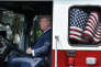 "President Donald Trump examines a fire truck from Wisconsin-based manufacturer Pierce during a ""Made in America"" product showcase event on the South Lawn at the White House in Washington, DC, on July 17, 2017. / AFP / Olivier Douliery"