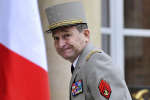 FILE - In this Saturday, March 19, 2016 file picture, French Army Chief of Staff, General Pierre de Villiers, arrives at the Elysee Palace to attend an emergency security meeting in Paris, France. France's military chief has quit over a dispute with President Emmanuel Macron over defense spending, in a new challenge to Macron's administration and his economic reforms. (AP Photo/Kamil Zihnioglu, File)