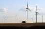 Moisson aux abords d'un champ d'éoliennes, à Allonnes (Sarthe), le 16 juillet.