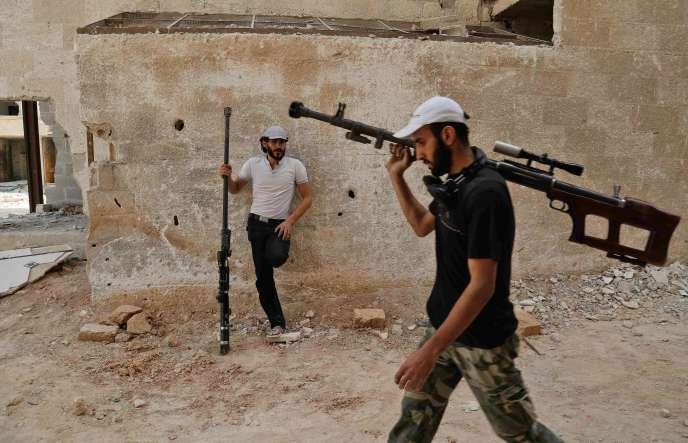 Des rebelles syriens de Faylaq al-Rahman, dans la Ghouta orientale, le 20 juillet.
