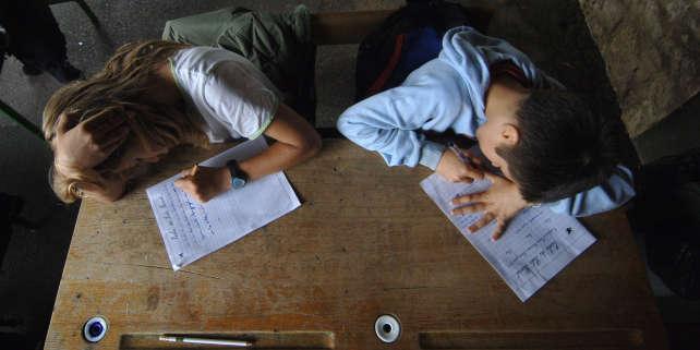 L'heure de la dictée, dans une école primaire de Caen. AFP PHOTO / MYCHELE DANIAU