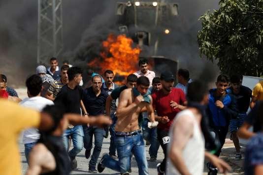 Heurts à Khobar à l'ouest de Ramallah, entre Palestiniens et armée israélienne, le 22 juillet.