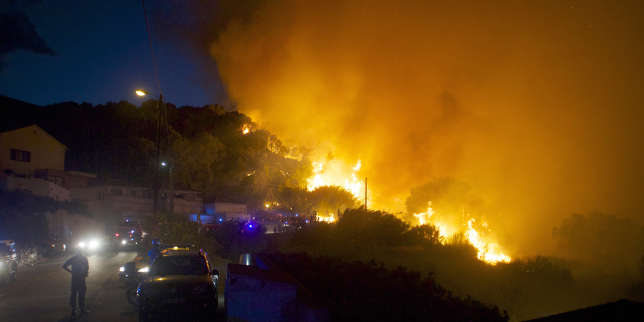 In this image dated Monday, July 24, 2017, firefighters work to stop a forest fire on a hillside near the village of Ortale, Corsica island, France. Hundreds of firefighters are battling blazes fanned by high winds in more than a dozen zones in the Riviera region of southern France. (AP Photo/Raphael Poletti)