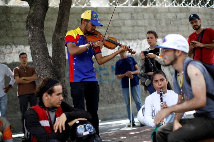 Lors des manifestations à Caracas, au Venezuela, le 26 juillet.