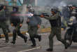 Riot security forces take up positions while clashing with demonstrators rallying against Venezuela's President Nicolas Maduro's government in Caracas, Venezuela, July 28, 2017.  REUTERS/Carlos Garcia Rawlins