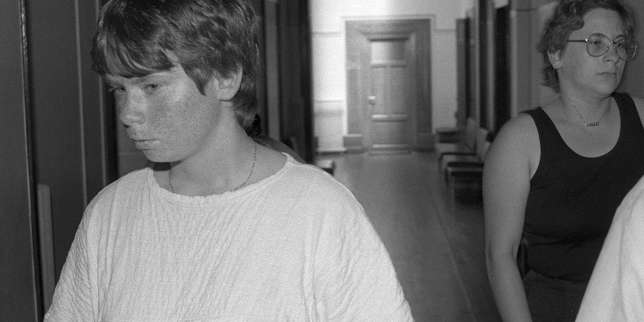 (FILES) This file photo taken on June 30, 1986 shows Murielle Bolle (L) et Marie-Ange Laroche arriving at the court in Dijon, eastern France, prior to a hearing as part of the inquiry into the murder of the four-year-old Gregory Villemin in 1984. Bolle is the sister in law of Bernard Laroche (a cousin of the four-year-old Gregory Villemin's father) who was charged with the murder of Gregory Villemin, based on evidence she gave when she was a teenager. Marie-Ange Laroche is the widow of Bernard Laroche. Murielle Bolle, a key witness in the Gregory case, will be confronted on July 28, 2017 with her cousin whose revelations were decisive in her recent incarceration, restarting the investigation into the murder of the four-year-old Gregory Villemin in 1984, 32 years after the events. Investigators involved in the case today want in particular to find out why Bolle went back on her original accusations, and last month she herself was placed under investigation in the case. / AFP / Eric Feferberg AND Eric Feferberg