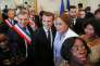 Le maire d'OrléansOlivier Carré et le président Emmanuel Macron lors d'une cérémonie de naturalisation à Orléans, le 27 juillet.