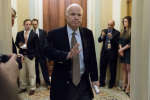 "FILE - In this June 22, 2017, file photo, Sen. John McCain, R-Ariz., arrives for a Senate Republican meeting on a health reform bill on Capitol Hill in Washington. McCain sent shockwaves through the Senate early Friday morning, July 28 when he cast the deciding vote rejecting the GOP's heath care effort to repeal and replace the Affordable Care Act. Reaction in red state Arizona has been more muted. McCain returned to the Senate earlier this week after being diagnosed with brain cancer. Despite making a decisive vote for opening debate on the measure, the Arizona senator's ultimate ""no"" vote effectively killed the legislation called the ""skinny repeal"" bill. (AP Photo/Andrew Harnik, File)"