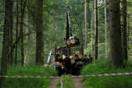 Forest guards are seen near logging machine during logging at Bialowieza forest, near Bialowieza village, Poland August 2, 2017. REUTERS/Kacper Pempel