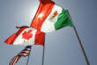 FILE - In this April 21, 2008 file photo, national flags representing the United States, Canada, and Mexico fly in the breeze in New Orleans where leaders of the North American Free Trade Agreement met. Renegotiation of the three-way trade pact are set to start on Aug. 16, 2017, in Washington D.C. (AP Photo/Judi Bottoni, File)