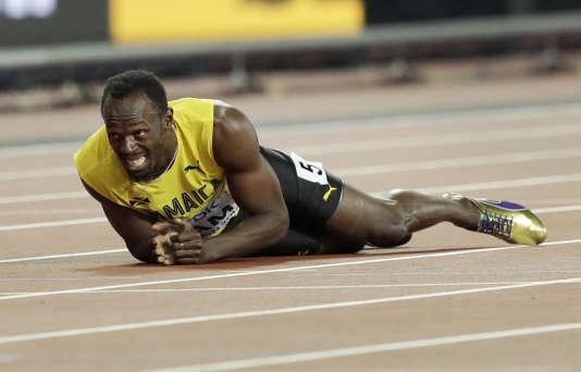 Usain Bolt à terre pendant le relais 4 x 100 m, le 12 août à Londres.