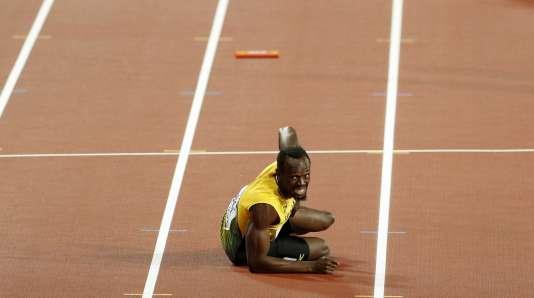 Usain Bolt à terre après sa blessure lors du 4 x 100 m.