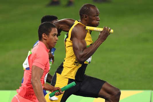 sain Bolt, lors de la finale du relais 4 × 100 m aux Jeux olympiques de Rio (Brésil), le 19 août 2016. ERIC FEFERBERG/AFP