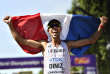 France's Yohann Diniz celebrates after winning the gold medal in the men's 50-kilometer race walk during the World Athletics Championships in London Sunday, Aug. 13, 2017. (AP Photo/Martin Meissner)