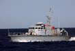 Un navire des garde-côtes libyens chasse le Golf Azzurro, qui appartient à l'ONG Proactiva Open Arms en mer Méditerranée, le 15 août.