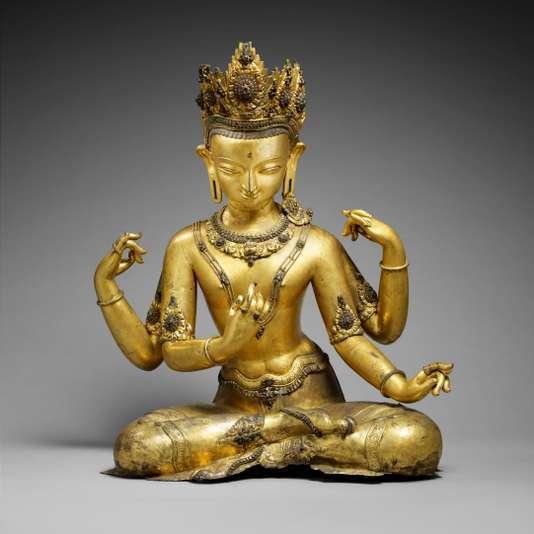 Statue de Vishnou portant sur sa tiare, l'oiseau Garuda, la monture du dieu de la trilogie hindou. Népal, XVIe siècle, en cuivre doré.