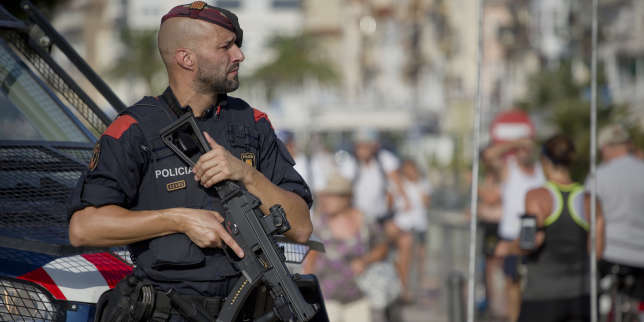 An armed policeman stands on the spot where terrorist were shot by police in Cambrils, Spain, Friday, Aug. 18, 2017. Spanish police on Friday shot and killed five people carrying bomb belts who were connected to the Barcelona van attack that killed at least 13, as the manhunt intensified for the perpetrators of Europe's latest rampage claimed by the Islamic State group. (AP Photo/Emilio Morenatti)