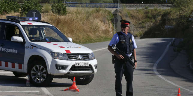 An armed police officer standa guard near Subirats, Spain, Monday, Aug. 21, 2017. A police operation was underway Monday in an area west of Barcelona, and a Spanish newspaper reports that the fugitive in the city's van attack has been captured. Regional police said officers shot a man wearing a possible explosives belt in Subirats, a small town 45 kilometers (28 miles) west of Barcelona. (AP Photo/Emilio Morenatti)