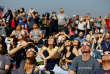 "People watch the solar eclipse on the lawn of Griffith Observatory in Los Angeles, California, U.S., August 21, 2017. Location coordinates for this image are 34°7'9""N 118°18'1""W.  REUTERS/Mario Anzuoni"
