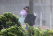 REFILE - QUALITY REPEAT A man holds onto a lamp post against strong wind as Typhoon Hato hits Hong Kong, China August 23, 2017. REUTERS/Tyrone Siu     TPX IMAGES OF THE DAY