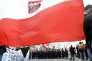 Derrière un drapeau polonais, des partisans du Jobbik, la formation d'extrême droite hongroise, commémorent les insurrections du « printemps des peuples » de 1848, à Budapest, en mars 2015.