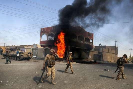 Les forces armées irakiennes dans le centre de Tal Afar, à l'ouest de Mossoul (Irak), le 26 août.