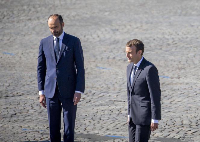 Edouard Philippe et Emmanuel Macron, pendant le défilé du 14-Juillet, à Paris.