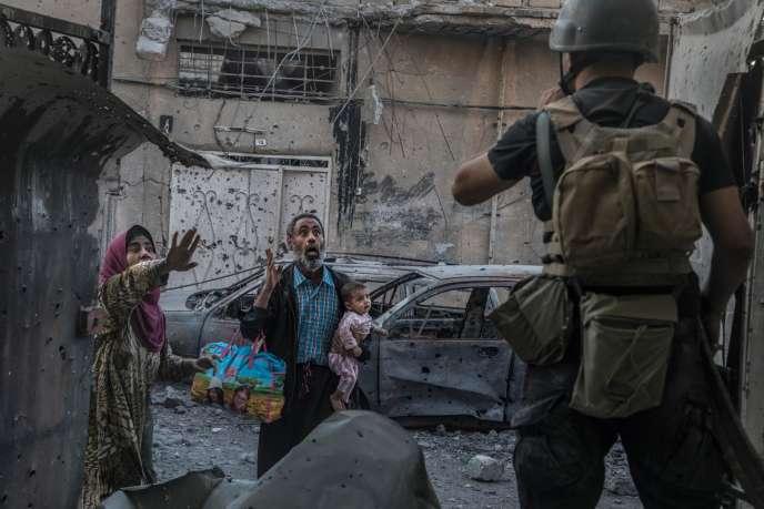 A Mossoul, le 2juin. Un commando de la première brigade des forces spéciales irakiennes combat l'EI, maison par maison.