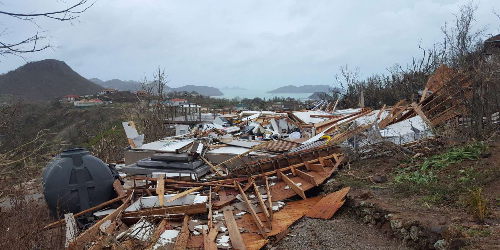 This handout picture released on the Twitter account of Quentin Liou on September 7, 2017 shows a house reduced to rubble on the French administered territory of Saint Barthelemy, after the passage of Hurricane Irma. Powerful Hurricane Irma cut a swathe of deadly destruction as it roared through the Caribbean, claiming at least nine lives and turning the tropical islands of St Martin and Barbuda into mountains of rubble. - RESTRICTED TO EDITORIAL USE - MANDATORY CREDIT