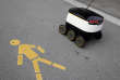 A Swiss Post self-driving delivery robot, capable of carrying up to 10 kg over 1 kilometer, with a speed up to 6 km/h, delivers a package from the department store Jelmoli during a press presentation for the start of the service in Zurich, Switzerland, September 8, 2017. REUTERS/Moritz Hager