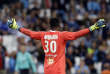 Marseille's goalkeeper Steve Mandanda gestures during the League One soccer match between Marseille and Rennes, at the Velodrome stadium, in Marseille, southern France, Sunday, Sept. 10, 2017. (AP Photo/Claude Paris)