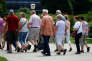 A group of elderly people walks in a park in Vienna, Austria June 28, 2017.   REUTERS/Leonhard Foeger - RC1943BC3FC0