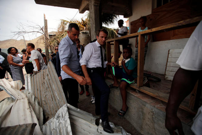 France's President Emmanuel Macron tries to find his way during his visit to the French Caribbean island of St. Martin September 12, 2017. Picture taken September 12, 2017. REUTERS/Christophe Ena/Pool