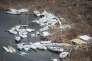 «10 % des humains sont responsables de la moitié des émissions actuelles issues de la consommation, tandis que la moitié de la population mondiale ne provoque que 10 % des émissions» (Illustrations des dégâts après le passage de l'ouragan Irma dans le quartier de la station balnéaire Anse-Marcel à Saint Martin, le 13 septembre).