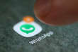 The WhatsApp app logo is seen on a smartphone in this picture illustration taken September 15, 2017. REUTERS/Dado Ruvic/Illustration