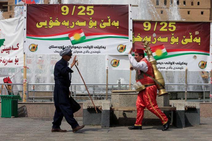 Pancartes appelant au référendum, à Erbil, le 21 septembre.