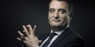 """(FILES) This file photograph taken on May 13, 2016, shows French far-right party Front National (FN) vice-president Florian Philippot as he poses in Paris. Florian Philippot, the leader of the far right-wing French National Front party and considered the right arm of Marine Le Pen, announced on September 21, 2017, that he had """"left"""" the formation, a sign of tensions within the party since their failure in the May 2017 presidential election. / AFP / JOEL SAGET"""