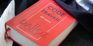 """A picture taken on May 24, 2012 shows a copy of the French labour code (""""code du travail"""" in French), in Quimper, western France. #journeetravail #journéetravail"""