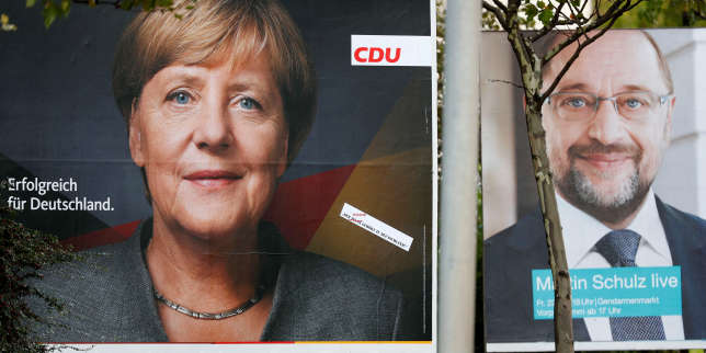 FILE PHOTO: Election campaign posters of the Christian Democratic Union party (CDU) with a headshot of German Chancellor Angela Merkel (L) and of Germany's Social Democratic Party SPD candidate for chancellor Martin Schulz for the upcoming general elections are pictured in Berlin, Germany, September 11, 2017.    REUTERS/Fabrizio Bensch/File Photo