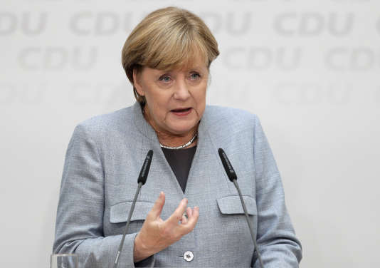 German Chancellor Angela Merkel speaks during a press conference after a board meeting of the Christian Democratic Union CDU in Berlin, Germany, Monday, Sept. 25, 2017, the day after the German parliament election. (AP Photo/Michael Sohn)