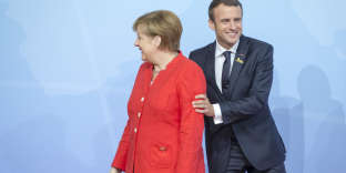 Emmanuel Macron et Angela Merkel à la réunion des chefs d'Etat et de gouvernement des pays membres du G20 à Hambourg, Allemagne, le 7 juillet.