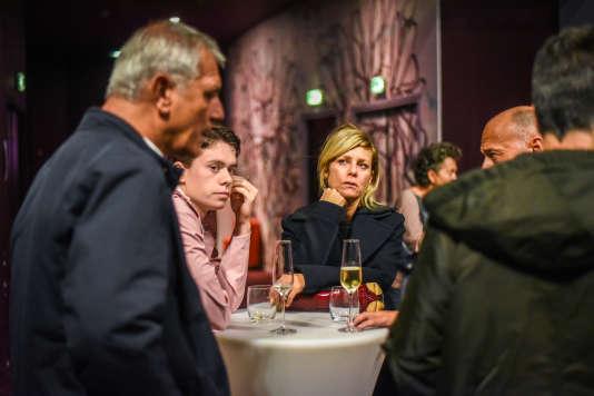 L'équipe du film « L'Atelier» (de gauche à droite ) : Laurent Cantet, Matthieu Lucci et Marina Foïs avant la projection au Gaumont Opéra à Paris, le 22 septembre.