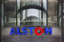 """FILE - This Wednesday, April 30, 2014, file photo shows the company logo of Alstom at their headquarters in Levallois-Perret, outside Paris, France. German industrial equipment maker Siemens AG said Tuesday Sept. 26, 2107, it has signed a memorandum of understanding to merge its train-building business with French rival Alstom, creating a """"new European champion"""" in the face of growing competition from China.(AP Photo/Christophe Ena, FILE)"""
