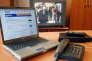 Vue prise le 13 février 2004 à Paris, au siège de Free, deuxème fournisseur d'accès Internet français, d'un boîtier modem Freebox entouré d'un téléphone, d'un ordinateur portable et d'un téléviseur. Le terminal Freebox permet aux abonnés au haut débit d'accéder via la prise de télépone également à une offre de téléphonie fixe à bas prix et aux principales chaînes de télévision numérique. Free est côté en bourse depuis le 30 janvier 2003. AFP PHOTO THOMAS COEX / AFP PHOTO / THOMAS COEX