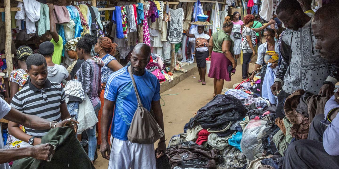 13th July 2017. Lome, Togo. Amah Ayivi, shopping for vintage clothes at the second-hand items section of the Hedzranawoe market in Lome, Togo.