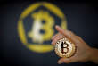FILE PHOTO: A Bitcoin (virtual currency) coin is seen in an illustration picture taken at La Maison du Bitcoin in Paris, France, June 23, 2017. REUTERS/Benoit Tessier/Illustration/File Photo